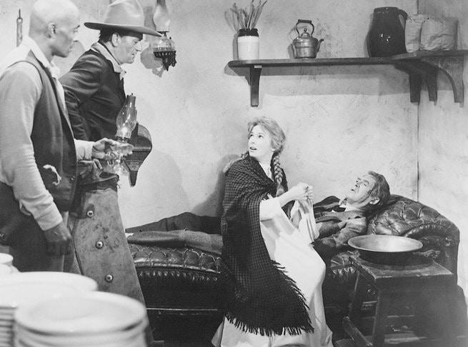 John Wayne, James Stewart, Vera Miles, Woody Strode